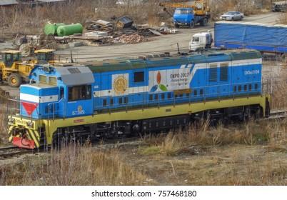 Kazakhstan, Ust-Kamenogorsk, november 2, 2017: Switcher or Shunter CKD6E2106. Locomotive, train