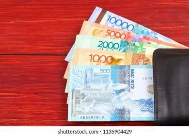 Kazakhstani tenge in the black wallet