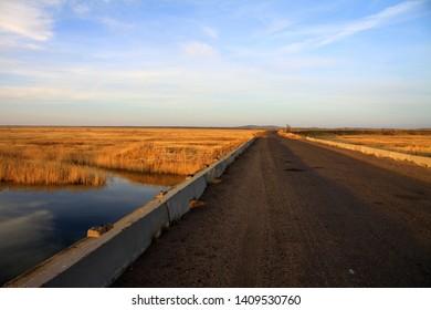 Kazakhstan.Karaganda region. Autumn on a sunny day. River esen. Sunset. Bridge.