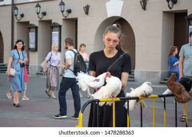 Kazan, Republic of Tatarstan, Russia - July 19, 2019. Bauman street, pedestrian street, favorite place for tourists and visitors to walk. Pigeons and girl in the foreground
