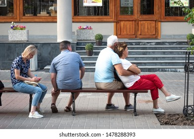 Kazan, Republic of Tatarstan, Russia - July 19, 2019. Bauman street, pedestrian street, favorite place for tourists and visitors to walk. People are sitting on bench