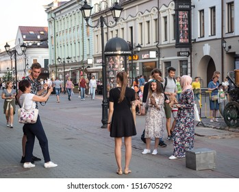Kazan, Republic of Tatarstan, Russia - July 19, 2019. Bauman street, pedestrian street, favorite place for tourists and visitors to walk. Tourists take pictures at the attraction.
