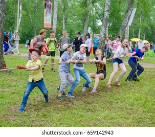 Kazan, Republic of Tatarstan, Russia - May 28, 2016: Children at competitions in tug of war. Sabantuy (Sabantui) is a traditional celebration of the end of spring field work.