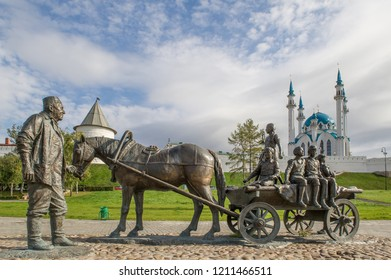 KAZAN, REPUBLIC OF TATARSTAN ,RUSSIA - OCTOBER 31, 2014: a bronze sculpture an elderly man leading a horse and cart with children , the sculpture depicts the philanthropist Asgat Galimzyanov