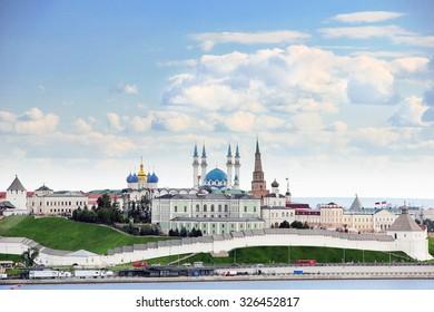 Kazan, Republic of Tatarstan, Russia. View of the Kazan Kremlin with: Presidential Palace, Soyembika Tower, Annunciation Cathedral, Qolsharif Mosque from the Kazanka River.