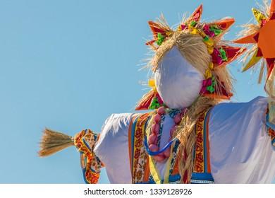 Kazan, Russia - 03.10.2019 Maslenitsa carnival. Colourfull scarecrow ready for burning.