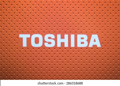 KAZAN, RUSSIA, 10 June 2015: water drops on the Toshiba logo