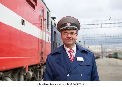 KAZAN, RUSSIA - 12 SEPTEMBER 2015 : a conductor  standing in front of the trans - siberian railway at the train station