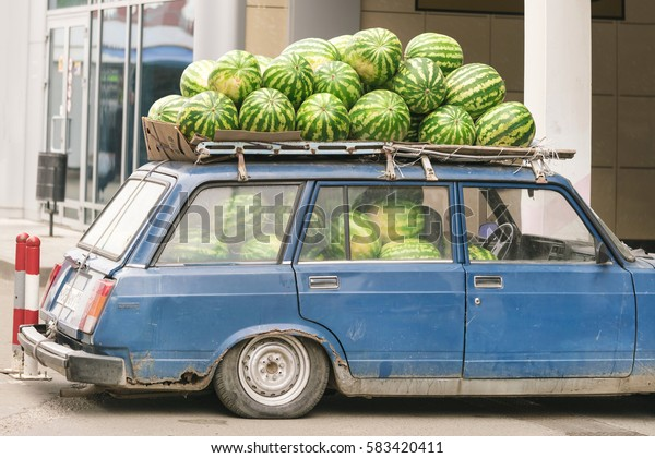 KAZAN, RUSSIA, 21 DECEMBER, 2015: Blue retro car with watermelons on the roof on a city street
