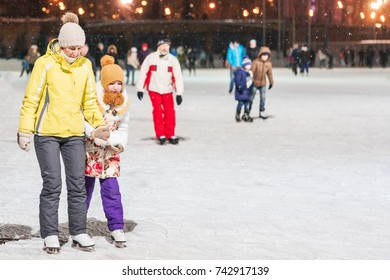 KAZAN, RUSSIA, 22 JANUARY, 2017: Woman with girl on skating rink in the evening