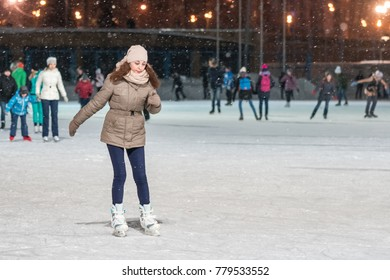 KAZAN, RUSSIA, 22 JANUARY, 2017: Woman on skating rink in the evening