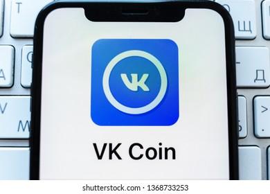Kazan, Russia - April 09, 2019: VK Coin app on Apple Iphone X screen. VK Coin logo.