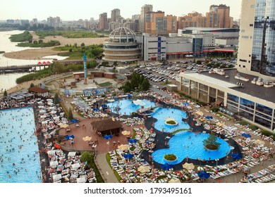 KAZAN, RUSSIA - AUGUST 06, 2020. Outdoor swimming pools of the Riviera entertainment complex at the banks of Kazanka river. Aerial view of the water park. City of Kazan, Republic of Tatarstan, Russia.
