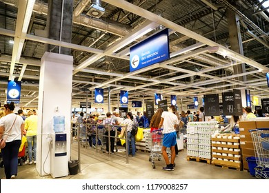 Kazan, Russia - August 31, 2018: Interior of large IKEA store with a wide range of products in Russia. The cashier and people in line