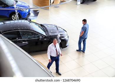 Kazan, Russia - August 31, 2018: Manager and buyer in car showroom of dealership Toyota in Kazan city