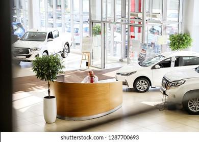 Kazan, Russia - August 31, 2018: Manager in car showroom of dealership Toyota in Kazan city
