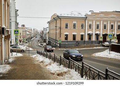 KAZAN, RUSSIA - DEC 10, 2017: Car traffic at Chernyshevsky street on winter day. Street named after N.Chernyshevsky - russian philosopher, democrat, scientist, literary critic, publicist and writer.