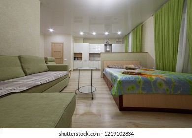 KAZAN, RUSSIA - DEC 7, 2017: Modern flat divided into kitchen and living zones in hotel Apartments on Bauman. Apartments located near Kazan Kremlin and Kul Sharif Mosque.