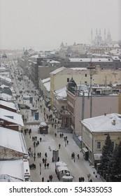 KAZAN, RUSSIA - DECEMBER 11, 2016: center of  - old orthodox church, kremlin, mosque Kull Shariff, Baumana street. Winter snow cloudy day