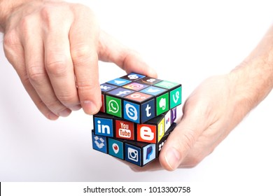 KAZAN, RUSSIA - January 27, 2018: Man's hand holds a cube with collection of popular social media logos printed on adhesive paper: Facebook, Twitter, LinkedIn, Instagram, WhatsApp, Youtube and other.