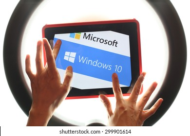 KAZAN, RUSSIA, July 17, 2015: Tablet computer with Windows 10 logo in ring studio light. Windows 10 is the new version of Windows OS by Microsoft Corporation; it starting July 29, 2015.