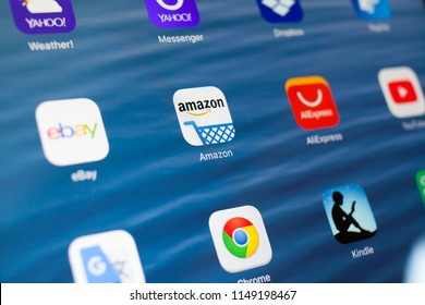 KAZAN, RUSSIA - JULY 3, 2018: Apple iPad with icons of social media. Amazon in center. Ebay, AliExpress application on screen.