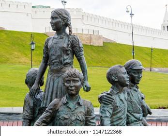 KAZAN, RUSSIA - JUNE 1, 2018: Close up of the kids on the monument to Kazan benefactor, the famous philanthropist of Tatarstan, Asgat Galimzyanov, near the Kazan Kremlin.