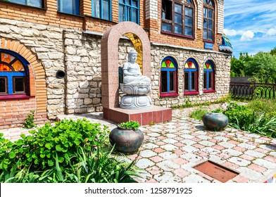 Kazan, Russia - June 11, 2018: Buddha statue outside the Temple of All Religions (Universal Temple)
