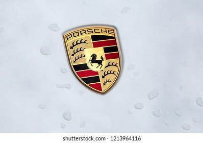 Kazan, Russia - June 12, 2018: Porsche automobile logo on the car with rain drops