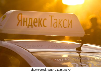 KAZAN, RUSSIA - JUNE 21, 2018: - Top of car with identification lights with logo of Yandex taxi at summer sunset