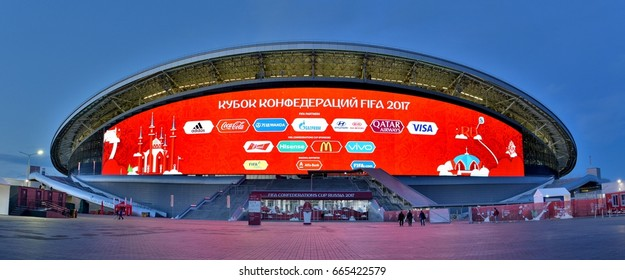 KAZAN, RUSSIA - JUNE 23, 2017. Exterior view of Kazan Arena stadium in Kazan, with people and advertisements.