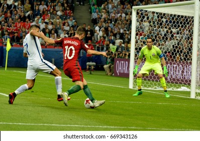 KAZAN, RUSSIA - JUNE 28, 2017. Portuguese midfielder Bernardo Silva against Chilean striker Alexis Sanchez and goalkeeper Claudio Bravo during FIFA Confederations Cup semi-final Portugal vs Chile.