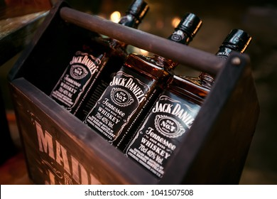KAZAN, RUSSIA - MARCH 8, 2018 - Bottles of Jack Daniels Tennessee whiskey No.7 in a dark wooden box with a handle. Highest selling American whiskey in the world