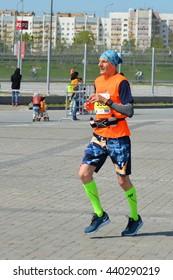 KAZAN, RUSSIA - MAY 15, 2016: marathon runners at the finish line after 42.2 km. Kazan Marathon 2016.
