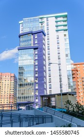 Kazan, Russia - May 9, 2019: Curved multi-storey building with a lot of glazed balconies. Creative design of modern residential complexes. Sunny day.