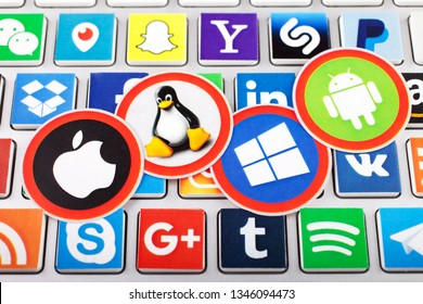 KAZAN, RUSSIA - NOVEMBER 20, 2017: Set of top brand operating system logos: Mac OS, Windows, Android, Linux, printed on paper and placed on computer keyboard.