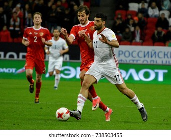 KAZAN, RUSSIA – OCTOBER 10, 2017. Russian player Aleksandr Yerokhin with Iranian striker Mehdi Taremi, during international friendly match Russia vs Iran at Kazan Arena stadium in Kazan.
