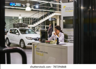 Kazan, Russia - October 19, 2017: Car and manager in showroom of dealership Renault in Kazan city