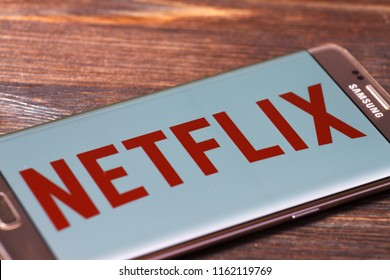 Kazan, Russian Federation - Aug 5, 2018: Netflix logo on a TV screen. Netflix app on Laptop screen. Netflix is an international leading subscription service for watching TV episodes and movies.