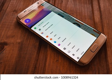 Kazan, Russian Federation - Sep 15, 2017:a hand holding a new Samsung Galaxy S8 mobile phone that displays the Google Play store app on the touch screen.