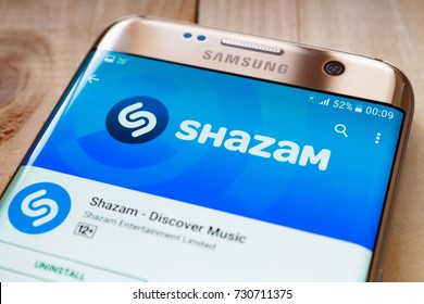 Kazan, Russian Federation - Sep 15, 2017: Samsung s7 Green with music service Shazam on the screen.