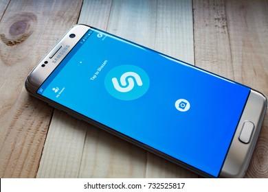 Kazan, Russian Federation - Sep 15, 2017: Samsung s7 Green with music service Shazam on the screen.