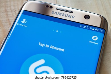 Kazan, Russian Federation - Sep 15, 2017: Samsung s7 Green with music service Shazam on the screen. iPhone 5c was created and developed by the Apple inc.