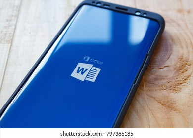 Kazan, Russian Federation - Sep 15, 2017: Vignette selective focus samsung s7 with Microsoft Word application showing on screen. Microsoft Word is a text document app for smartphones.