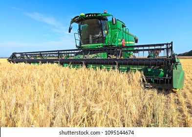 Kazanka, Ukraine - July 11: John Deere Combine Harvester T670 harvesting grain in the field near the village Kazanka, South Ukraine July 11, 2017