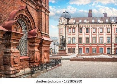 Kazan/Russia - 03/10/2017. Monument to Chaliapin near the hotel and view of the lower tier of the old brick bell tower on Bauman Street in Kazan