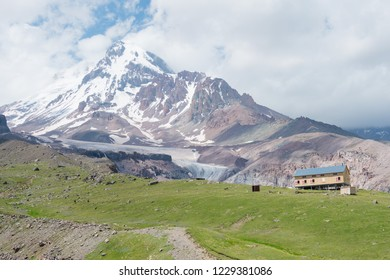 Kazbegi, Georgia - Jun 29 2018: Mountain hut at Mount Kazbek (5047m). a famous landscape in Kazbegi, Mtskheta-Mtianeti, Georgia.