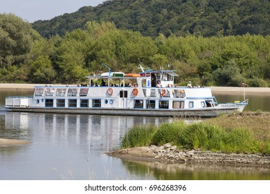 KAZIMIERZ DOLNY - AUGUST 9, 2017: Cruise ship with tourists on the river Vistula. Cruises on the Vistula River are a great attraction for tourists, especially on sunny days