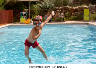 Kdis, jump in water pool on holiday, family vacation in summer resort