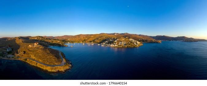 Kea Tzia island, Cyclades, Greece. Aerial drone panoramic photo of the bay at sunset time. Korissia port, Gialiskari, Vourkari marina and Kokka beach